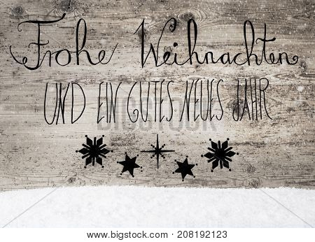 Black German Calligraphy Frohe Weihnachten Und Ein Gutes Neues Jahr Means Merry Christmas And Happy New Year. Rustic Wooden Background With Snow