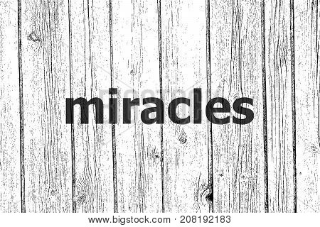 Text Miracles. Business Concept . Wooden Texture Background. Black And White