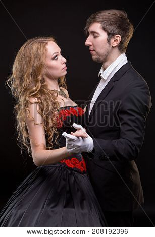 Couple dancing the waltz on black background