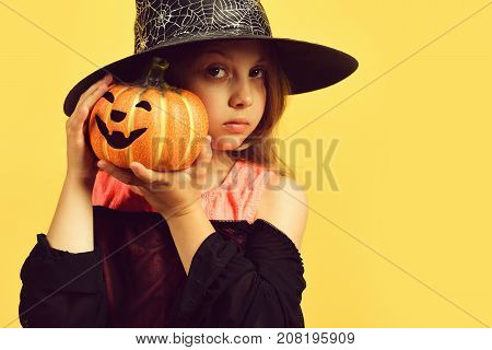 Halloween And Costume Party Concept. Kid In Black Witch Hat