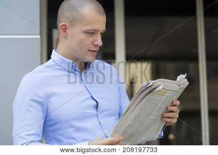 Portrait Of Young Man While Read Newspapers