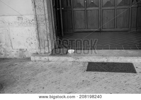 Beggar's place in front of the porch of a church