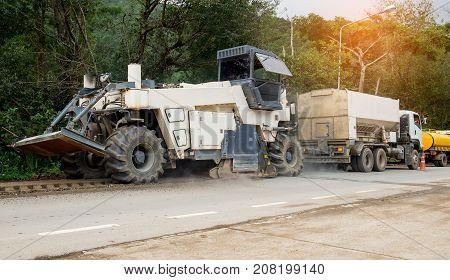 Asphalt scraper is running construction on public roads.