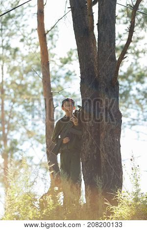 Child With A Gun Playing Laser Tag In The Forest