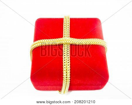 Red luxury gift box with gold chain around the box