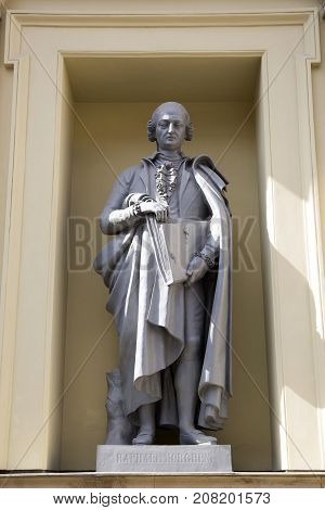 SAINT PETERSBURG, RUSSIA, MAY 04, 2017:Statue of Raphael Morghen on the facade of the New Hermitage Building in St Petersburg Russia.