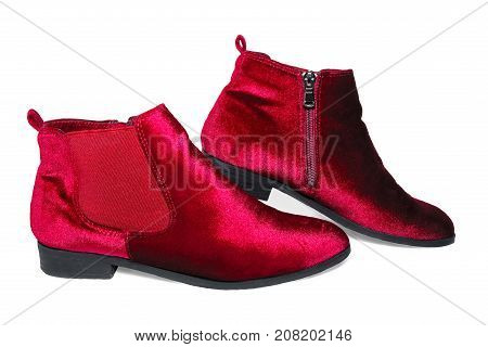 Lady's red velvet ankle boots isolated on white background.
