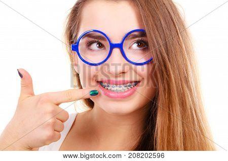 Happy Nerdy Teenage In Eyeglasses Showing Braces
