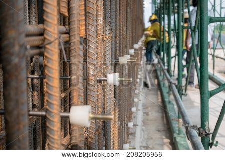 Reinforcement of concrete work. Using steel wire for securing steel bars with wire rod for reinforcement of concrete or cement. focus to steel wirestock poster