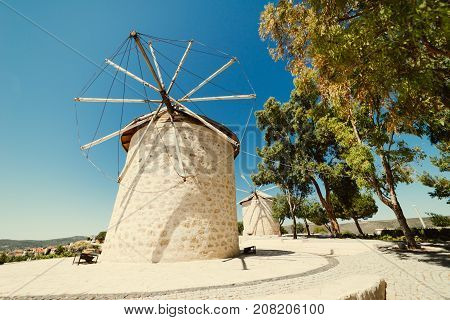 Girl near old windmills. Summer holidays in europe, vacation, traveler. Spain, greece, turkey.