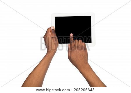 Holding and pointing on blank screen of digital tablet. African-american using device with blank screen, copy space for advertisement, isolated on white background. Press the button. Point of view