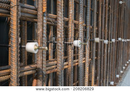 Reinforcement of concrete work. Using steel wire for securing steel bars with wire rod for reinforcement of concrete or cement. focus to steel wirestock