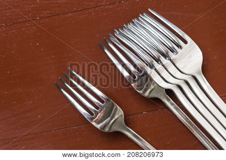 Flat Lay Above Metal Forks On The Wooden Table