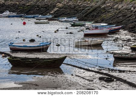 Fishing boats in Domaio port Pontevedra Spain on July 12 2014. It is a small village which is part of the municipality of Moaña in the Vigo estuary Galicia Spain