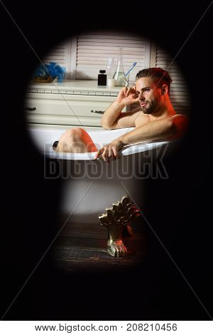 Macho Sitting Naked In Bathtub With Dreamy Face