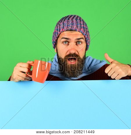 Hipster With Beard And Busy Face Shows Thumbs Up.