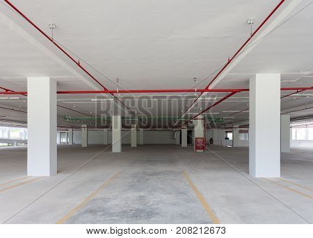 Empty parking garage underground interior in apartment or business building office