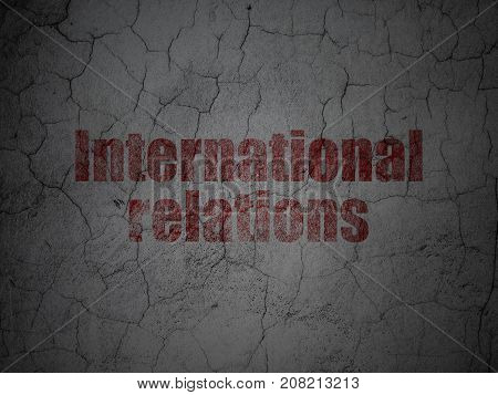 Politics concept: Red International Relations on grunge textured concrete wall background