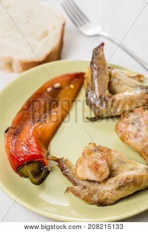 Fried Chicken Wings Served With Fried Paprika And Bread