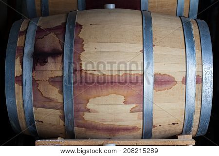 front view closeup of a wine oak wood barrel stained with red