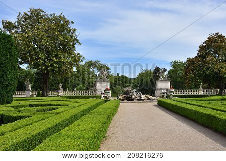 Queluz Portugal - June 3 2017: View on the entrance in Neptune garden baroque fountain and sculptures by sculptor John Cheere in the Queluz Royal Palace