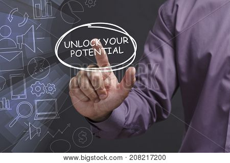 Business, Technology, Internet And Network Concept. Young Businessman Shows The Word: Unlock Your Po