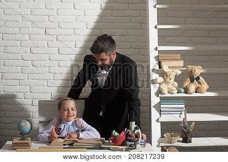 Education And Family Relationship Concept. Schoolgirl And Her Dad