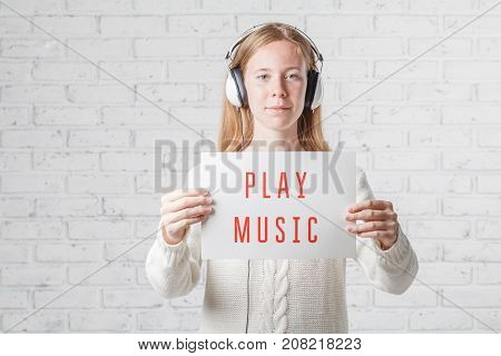 People, Leisure And Technology Concept - Happy Woman Or Teenage Girl In Headphones Listening To Musi