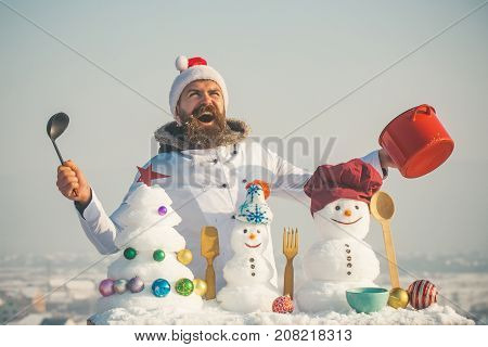 Happy Man In Santa Hat And Uniform On Winter Day