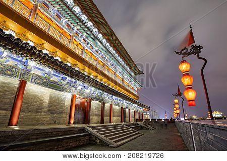 Xian City Wall At Night, Shaanxi Province, China.