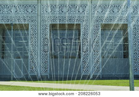 RUSSIA SOCHY - SEPTEMBER 2017. Fragment of the facade of the building of the Sochi Automobile Museum in the Olympic Park with an ornament in the Asian style visible through the fountain in the foreground.