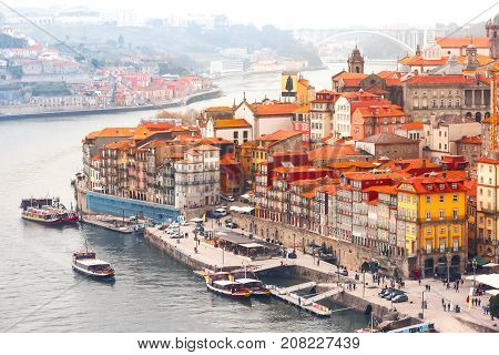 Aerial view with traditional multicolored quaint houses in Old town of Porto in the cloudy morning, Portugal