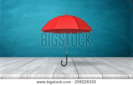 3d rendering of a single red classic umbrella with an open canopy standing above a wooden desk on blue background. Business insurance. Safety measures. Hide from problems.