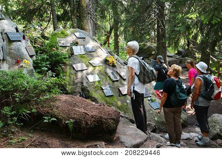 POPRADSKE PLESO, SLOVAKIA - AUGUST 27, 2015: People visit the symbolic cemetery in High Tatras a memorial to people who died in the mountains