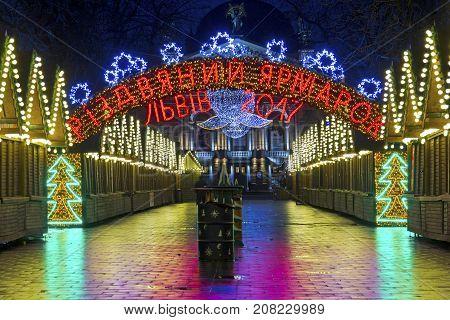 LVIV, UKRAINE - DECEMBER 11, 2016: Christmas holiday market in the center of Lviv on Liberty avenue near Opera Theater