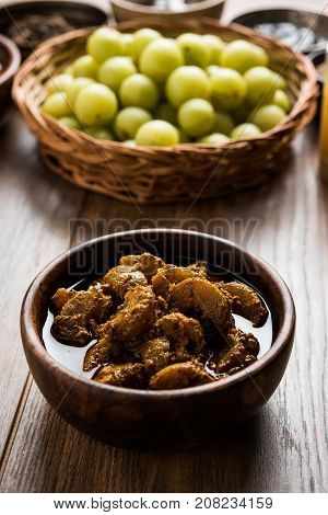 Stock photo of Amla/Avla/Aavla and it's by product called pickle or achar, selective focus