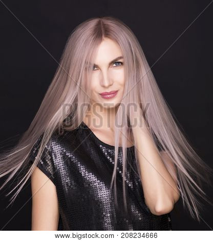 Photo of a young beautiful woman with magnificent purple hair