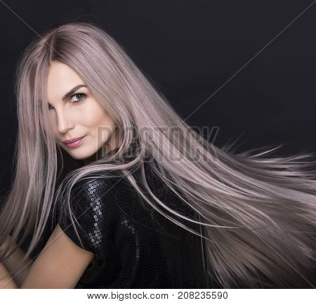 Beautiful Blue Eyes of Young Gorgeous Woman.Blond girl.close-up. Art portrait.Beautiful healthy hair.Beauty salon.flying hair
