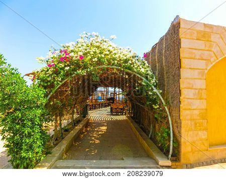 Sharm El Sheikh, Egypt - September 22, 2017: Outdoor restaurant and beach at the luxury hotel at Sharm el Sheikh, Egypt on September 22, 2017