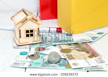 Ruble mortgage. Russian money and a small house on the background of a business folder
