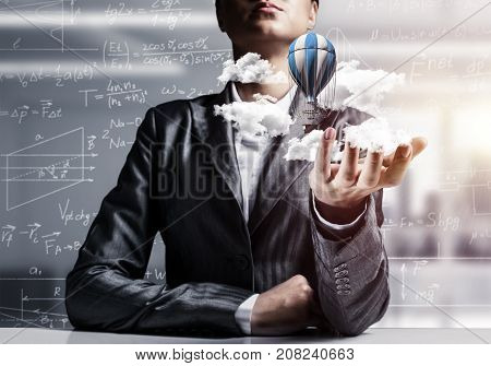 Closeup of business woman in suit presenting flying aerostate among clouds in her palm with business sketches on background. 3D rendering.