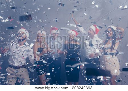 Chilling Group Of Jet Set In Luxury Outfits, Shirts, X Mas Headwear, Rich, Wealth, Amazed, Laughing,