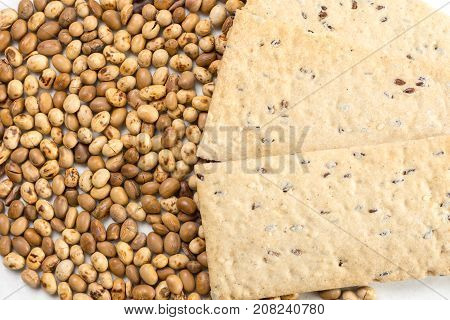 Soya Beans With Flax Chips On The White Marble Background