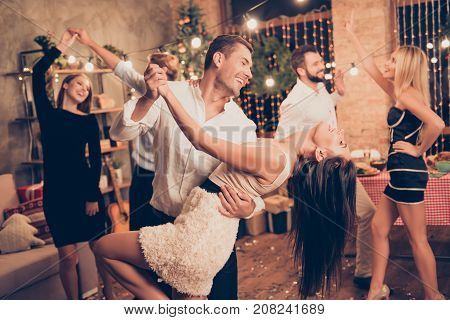 Excited, Welldressed, Cheerful, Elegant Husband Holds Cute Wife, Lean, She Bending Over, Raised Up L