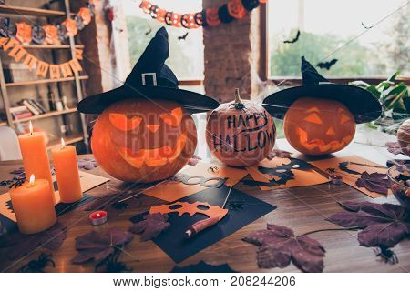 Close Up Of Cutted Pumpkins, Leaves, Spiders Nets, Head Wear Of Witch, Burning Candles, On Top Of Wo
