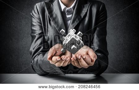 Cropped image of business woman in suit presenting multiple cubes in hands as symbol of innovations. 3D rendering.