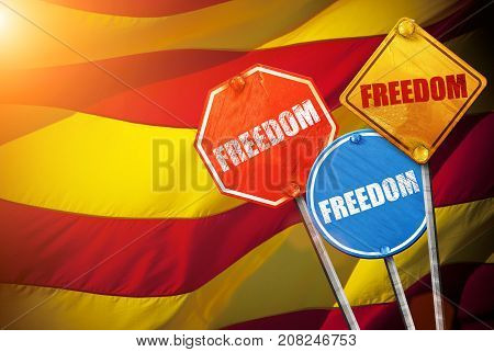 Political slogan in the form of traffic signs with Flag of Catalonia on the background. Signs with word FREEDOM. Independence of catalonia. Referernundum and protests in Catalonia, Barcelona.