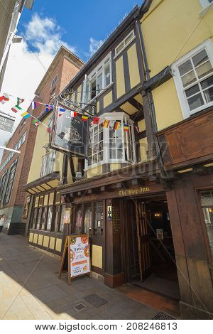 Exeter Devon England 22 July 2016: The appearance of the ancient pub Ship Inn in the center of the Exeter