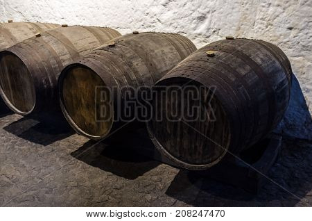 Old wooden barrels for wine in wine cellar, Wine symbol, Old barric wine barrels