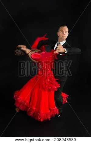 Ballrom Dance Couple In A Dance Pose Isolated On Black Background
